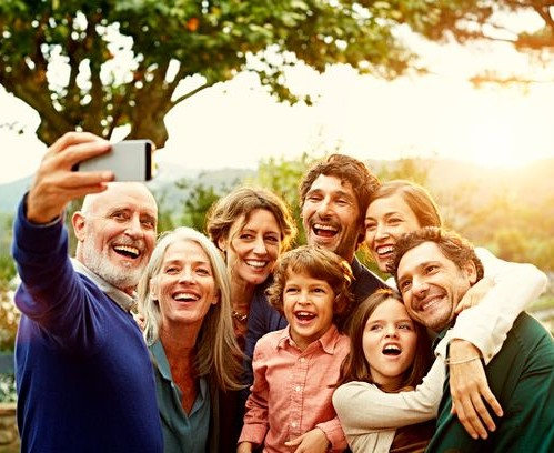 Cheerful-family-taking-selfie