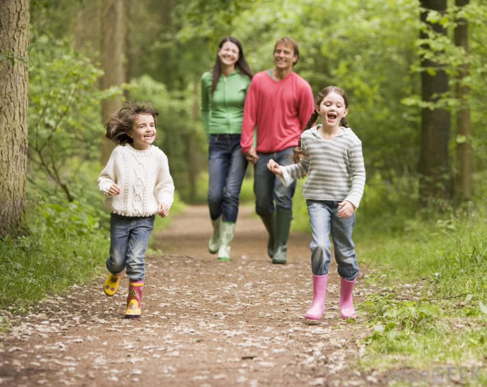 family-walking-through-the-woods