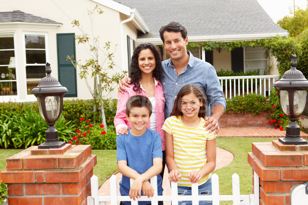 4328003_stock-photo-hispanic-family-outside-home